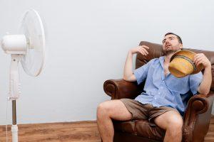 flushed-man-hot-in-front-of-fan