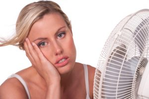 woman-in-front-of-fan