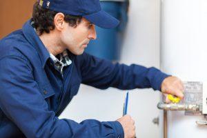 plumber-repairs-water-heater